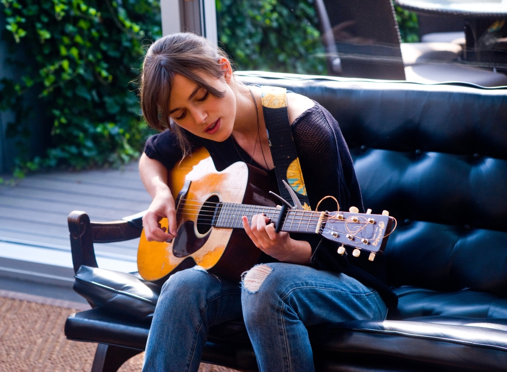 A girl with a guitar and some stories to tell. Purest presentation of music but unfortunately not what current labels are looking for. photo source: standforddaily.com